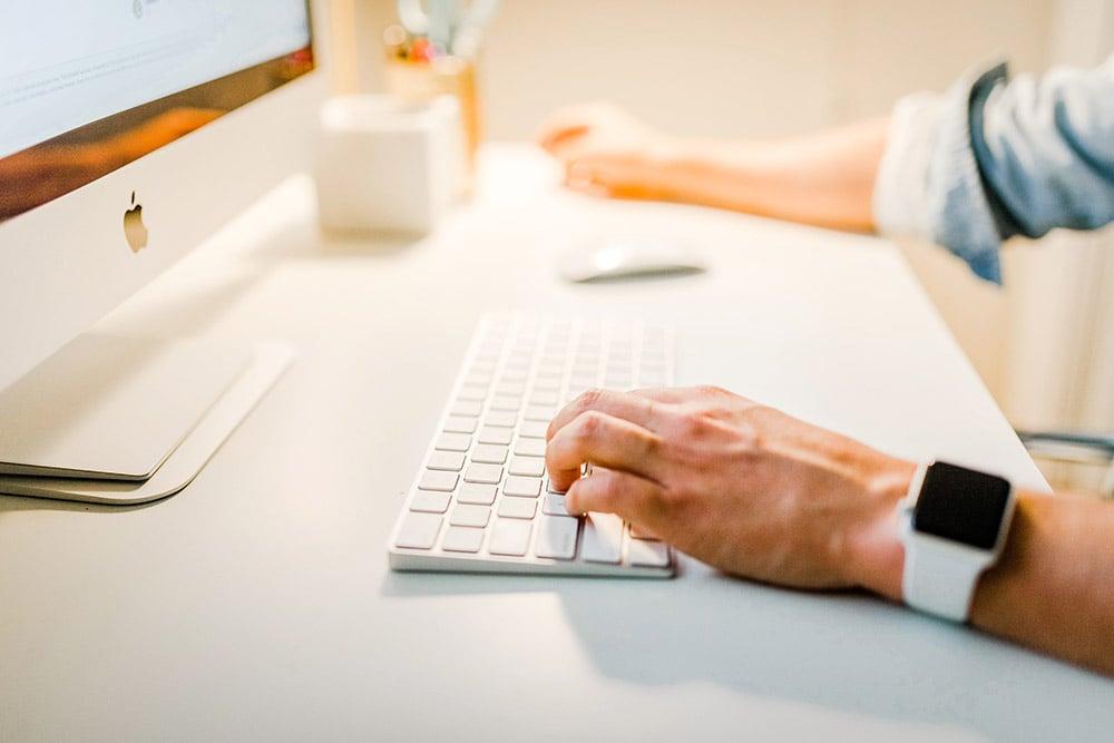 person working on a mac desktop